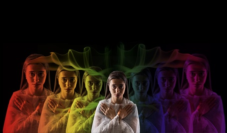 young girl meditating with aura colors
